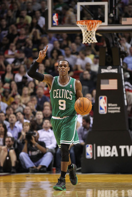 MIAMI - NOVEMBER 11:  Rajon Rondo #9 of the Boston Celtics brings the ball up the court during a game against the Miami Heat at American Airlines Arena on November 11, 2010 in Miami, Florida. NOTE TO USER: User expressly acknowledges and agrees that, by d
