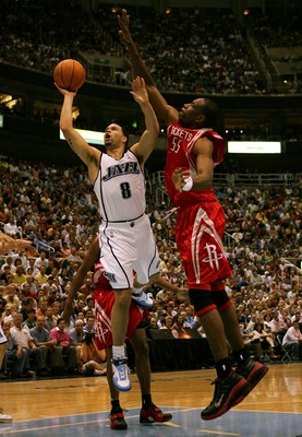 SALT LAKE CITY - APRIL 28:  Deron Williams #8 of the Utah Jazz lays up the ball over Dikembe Mutombo #55 of the Houston Rockets during Game Four of the Western Conference Quarterfinals during the 2007 NBA Playoffs at Energy Solutions Arena on April 28, 20