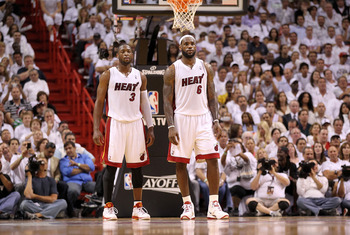 MIAMI, FL - APRIL 27:  Dwyane Wade #3 and LeBron James #6 of the Miami Heat talk during game five of the Eastern Conference Quarterfinals in the 2011 NBA Playoffs against the Philadelphia 76ers at American Airlines Arena on April 27, 2011 in Miami, Florid