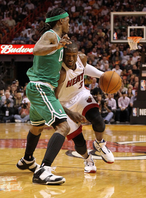 MIAMI - NOVEMBER 11:  Dwyane Wade #3 of the Miami Heat drives against Marquis Daniels #8 during a game against the Boston Celtics at American Airlines Arena on November 11, 2010 in Miami, Florida. NOTE TO USER: User expressly acknowledges and agrees that,