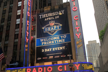 NEW YORK, NY - APRIL 28:  A taxi drives down the Avenue of the AMericas past Radio City Music Hall during the 2011 NFL Draft at Radio City Music Hall on April 28, 2011 in New York City.  (Photo by Chris Trotman/Getty Images)