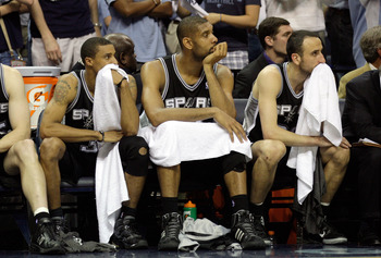 MEMPHIS, TN - APRIL 25: George Hill #3, Tim Duncan #21 and Manu Ginobili #20 of the San Antonio Spurs watch from the bench in the fourth quarter during the game against the Memphis Grizzlies in Game Four of the Western Conference Quarterfinals in the 2011