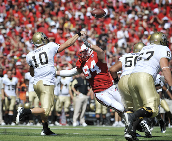 LINCOLN, NEBRASKA - SEPTEMBER 11: Idaho Vandals quarterback Nathan Enderle #10 throws a pass down field over Nebraska Cornhuskers defensive tackle Jared Crick #94 during second half action of their game at Memorial Stadium on September 4, 2010 in Lincoln,