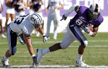 FORT WORTH, TX - OCTOBER 16:  Wide receiver Jeremy Kerley #85 of the TCU Horned Frogs carries the ball against defensice back Bryan Kariya #33 of the BYU Cougars at Amon G. Carter Stadium on October 16, 2010 in Fort Worth, Texas.  TCU beat BYU 31-3.  (Pho