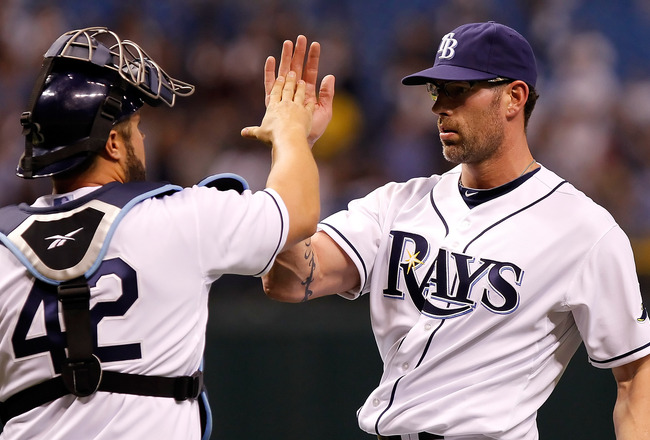 ST. PETERSBURG, FL - APRIL 15:  Pitcher Kyle Farnsworth #43 of the Tampa Bay Rays celebrates the last out with catcher Kelly Shoppach #10 during a game against the Minnesota Twins at Tropicana Field on April 15, 2011 in St. Petersburg, Florida.  (Photo by