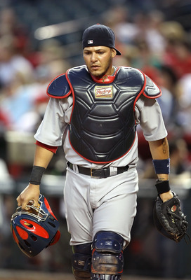 PHOENIX, AZ - APRIL 12:  Catcher Yadier Molina #4 of the St. Louis Cardinals in action during the Major League Baseball game against the Arizona Diamondbacks at Chase Field on April 12, 2011 in Phoenix, Arizona.  The Diamondbacks defeated the Cardinals 13