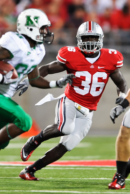 COLUMBUS, OH - SEPTEMBER 2: Brian Rolle #36 of the Ohio State Buckeyes pursues ballcarrier Courtney Edmonson #80 of the Marshall Thundering Herd at Ohio Stadium on September 2, 2010 in Columbus, Ohio. (Photo by Jamie Sabau/Getty Images)