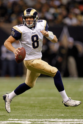 NEW ORLEANS, LA - DECEMBER 12:  Quarterback Sam Bradford #8 of the St. Louis Rams looks to throw a pass during the game against the New Orleans Saints at the Louisiana Superdome on December 12, 2010 in New Orleans, Louisiana. The Saints defeated the Rams