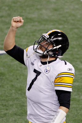 ARLINGTON, TX - FEBRUARY 06:  Ben Roethlisberger #7 of the Pittsburgh Steelers celebrates after Rashard Mendenhall #34 ran for an eight yard touchdown against the Green Bay Packers in the third quarter of Super Bowl XLV at Cowboys Stadium on February 6, 2