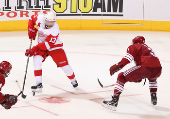 GLENDALE, AZ - APRIL 18:  Pavel Datsyuk #13 of the Detroit Red Wings skates with the puck in Game Three of the Western Conference Quarterfinals against the Phoenix Coyotes during the 2011 NHL Stanley Cup Playoffs at Jobing.com Arena on April 18, 2011 in G