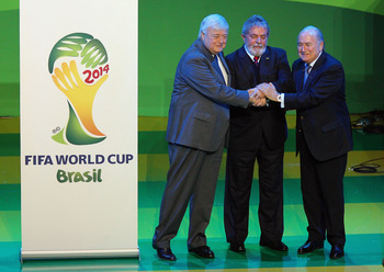 JOHANNESBURG, SOUTH AFRICA - JULY 08: Brazilian Football Federation president Ricardo Terra Teixeira, Brazilian President Luiz Inacio Lula da Silva and FIFA President Joseph Sepp Blatter pose during the launch of 2014 FIFA World Cup Brazil Official emblem