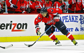 WASHINGTON , DC - APRIL 23:  Alex Ovechkin #8 of the Washington Capitals skates the puck across the blue line against the New York Rangers in Game Five of the Eastern Conference Quarterfinals during the 2011 NHL Stanley Cup Playoffs at the Verizon Center