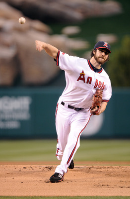 ANAHEIM, CA - APRIL 22:  Dan haren #24 of the Los Angeles Angels of Anaheim pitches against the Boston Red Sox during the first inning at Angel Stadium on April 22, 2011 in Anaheim, California.  (Photo by Harry How/Getty Images)
