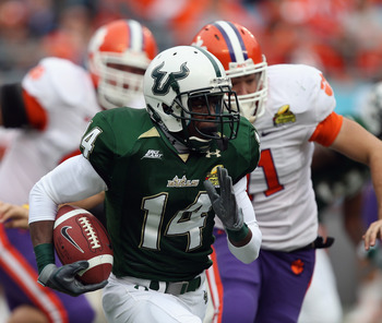 CHARLOTTE, NC - DECEMBER 31:  Terrence Mitchell #14 of the USF Bulls runs with the ball against the Clemson Tigers during their game at Bank of America Stadium on December 31, 2010 in Charlotte, North Carolina.  (Photo by Streeter Lecka/Getty Images)