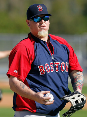 FORT MYERS, FL - FEBRUARY 19:  Pitcher Bobby Jenks #52 of the Boston Red Sox throws during a Spring Training Workout Session at the Red Sox Player Development Complex on February 19, 2011 in Fort Myers, Florida.  (Photo by J. Meric/Getty Images)