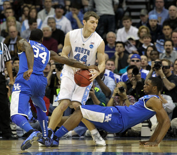 NEWARK, NJ - MARCH 27:  Tyler Zeller #44 of the North Carolina Tar Heels in action against DeAndre Liggins #34 and Terrence Jones #3 of the Kentucky Wildcats during the east regional final of the 2011 NCAA men's basketball tournament at Prudential Center