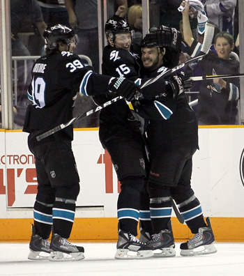 SAN JOSE, CA - MAY 01:  Ian White #9 is congratulated by Dany Heatley #15 and Logan Couture #39 of the San Jose Sharks after he scored a goal in the first period against the Detroit Red Wings in Game Two of the Western Conference Semifinals during the 201