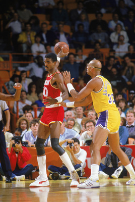 INGLEWOOD -1987:  Ralph Sampson #50 of the Houston Rockets guards the ball from Kareem Abdul-Jabbar #33 of the Los Angeles Lakers during a game in the1987-88 season at the Forum in Inglewood, Califronia.. NOTE TO USER: User expressly acknowledges and agre
