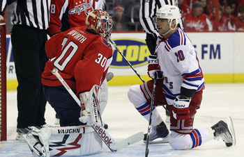 WASHINGTON, DC - APRIL 15: Michal Neuvirth #30 of the Washington Capitals and Marian Gaborik #10 of the New York Rangers exchange a few words during a play stoppage in the first period in Game Two of the Eastern Conference Quarterfinals during the 2011 NH