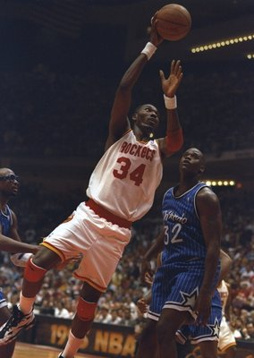 14 Jun 1995:  Center Hakeen Olajuwon of the Houston Rockets goes up for two during a Finals game against the Orlando Magic at The Summit in Houston, Texas.  The Rockets won the game, 113-101. Mandatory Credit: Allsport  /Allsport Mandatory Credit: Allspor