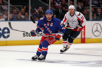 NEW YORK, NY - APRIL 17:  Chris Drury #23 of the New York Rangers skates against Mike Knuble #22 of the Washington Capitals in Game Three of the Eastern Conference Quarterfinals during the 2011 NHL Stanley Cup Playoffs at Madison Square Garden on April 17