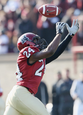 CAMBRIDGE, MA - NOVEMBER 20:  Treavor Scales #24 of the Harvard Crimson makes the catch against the Yale Bulldogs on November 20, 2010 at Harvard Stadium in Cambridge, Massachusetts.  Harvard defeated Yale 28-21.  (Photo by Elsa/Getty Images)