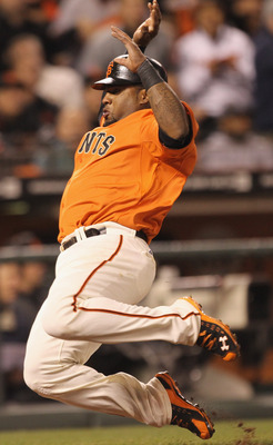 SAN FRANCISCO, CA - APRIL 22:  Pablo Sandoval #48 of the San Francisco Giants scores on a ground out by Pat Burrell #5 in the seventh inning of their game against the Atlanta Braves at AT&amp;T Park on April 22, 2011 in San Francisco, California.  (Photo by E