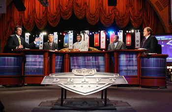 NEW YORK - APRIL 29:  (L-R) Mel Kiper, Chris Mortensen, Michael Irvin, Tom Jackson and Chris Berman of ESPN broadcast their coverage during the 2006 NFL Draft on April 29, 2006 at Radio City Music Hall in New York, New York. (Photo by Chris Trotman/Getty