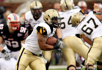 DALLAS, TX - DECEMBER 30:  Running back Patrick Mealy #5 of the Army Black Knights runs the ball against the SMU Mustanges during the Bell Helicopter Armed Forces Bowl at Gerald J. Ford Stadium on December 30, 2010 in Dallas, Texas.  (Photo by Ronald Mart