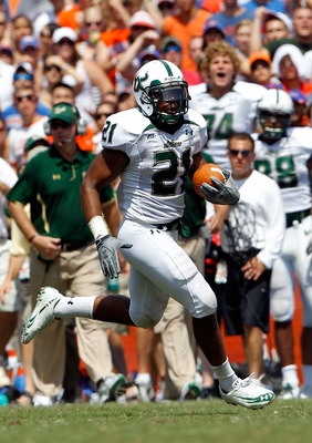 GAINESVILLE, FL - SEPTEMBER 11:  Demetris Murray #21 of the South Florida Bulls runs for yardage during a game against the Florida Gators at Ben Hill Griffin Stadium on September 11, 2010 in Gainesville, Florida.  (Photo by Sam Greenwood/Getty Images)