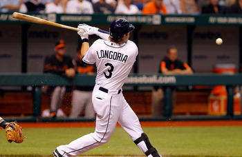 ST. PETERSBURG, FL - APRIL 01:  Infielder Evan Longoria #3 of the Tampa Bay Rays fouls off a pitch against the Baltimore Orioles during the Opening Day game at Tropicana Field on April 1, 2011 in St. Petersburg, Florida.  (Photo by J. Meric/Getty Images)