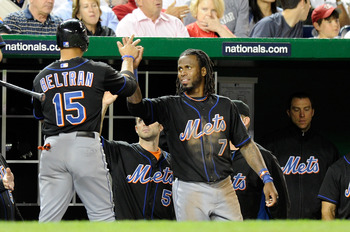 WASHINGTON, DC - APRIL 28:  Carlos Beltran #15 of the New York Mets is congratulated by Jose Reyes #7 after scoring in the sixth inning against the Washington Nationals at Nationals Park on April 28, 2011 in Washington, DC.  (Photo by Greg Fiume/Getty Ima