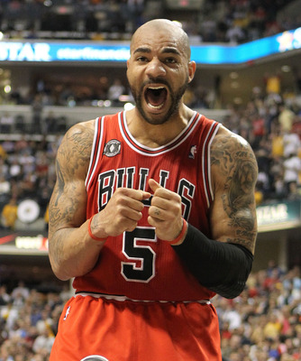 INDIANAPOLIS, IN - APRIL 21:  Carlos Boozer #5 of the Chicago Bulls reacts to a foul being called on a teammate during the game against the Indiana Pacers in Game three of the Eastern Conference Quarterfinals in the 2011 NBA Playoffs on April 21, 2011  at