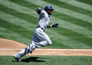 LOS ANGELES, CA - MAY 01:  Cameron Maybin #24 of the San Diego Padres runs home to score a run for a 3-0 lead over the Los Angeles Dodgers during the second inning at Dodger Stadium on May 1, 2011 in Los Angeles, California.  (Photo by Harry How/Getty Ima