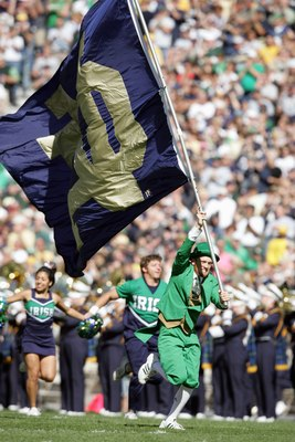 SOUTH BEND, IN - OCTOBER 07:  The mascot of Notre Dame Fighting Irish carries the flag onto the field during the game against the Stanford Cardinal on October 7, 2006 at Notre Dame Stadium in South Bend, Indiana. (Photo by Andy Lyons/Getty Images)
