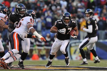 BALTIMORE - DECEMBER 20:  Ray Rice #27 of the Baltimore Ravens runs the ball during the game against the Chicago Bears at M&T Bank Stadium on December 20, 2009 in Baltimore, Maryland. The Ravens defeated the Bears 31-7. (Photo by Larry French/Getty Images