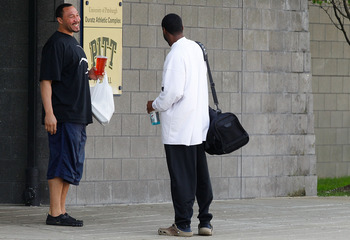 PITTSBURGH - APRIL 26:  A day after the NFL lockout was lifted, Charlie Batch #16 of the Pittsburgh Steelers shares a laugh with a University of Pittsburgh employee before leaving the South Side training facility on April 26, 2011 in Pittsburgh, Pennsylva