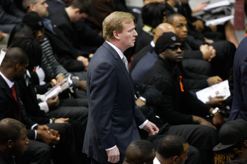 WESTWEGO, LA - DECEMBER 22:  NFL Commissioner Roger Goodell walks in during the funeral for Cincinati Bengals player Chris Henry at the Alario Center  on December 22, 2009 in Westwego, Louisiana.  Henry died last week after he fell out of the bed of picku