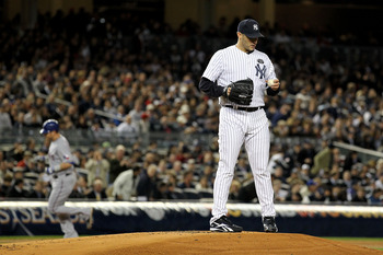 NEW YORK - OCTOBER 18:  Starting pitcher Andy Pettitte #46 of the New York Yankees reacts as Josh Hamilton #32 of the Texas Rangers rounds third base on his 2-run home tun in the top of the first inning of Game Three of the ALCS during the 2010 MLB Playof