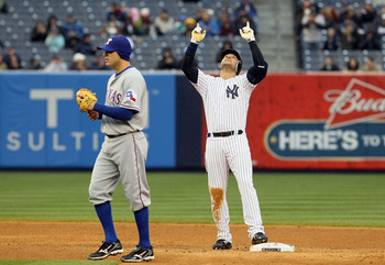 NEW YORK, NY - APRIL 16: Nick Swisher #33 of the New York Yankees celebrates a double as Ian Kinsler #5 of the Texas Rangers looks on on April 16, 2011 at Yankee Stadium in the Bronx borough of New York City.  (Photo by Jim McIsaac/Getty Images)