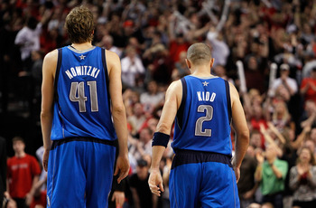 PORTLAND, OR - APRIL 23:   Dirk Nowitzki #41 and Jason Kidd #2 of the Dallas Mavericks walks off the floor against the Portland Trail Blazers in Game Four of the Western Conference Quarterfinals in the 2011 NBA Playoffs on April 23, 2011 at the Rose Garde