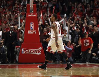 CHICAGO, IL - APRIL 26: Derrick Rose #1 of the Chicago Bulls smiles as he walks off of the court as fans cheer during a time-out against the Indiana Pacers in Game Five of the Eastern Conference Quarterfinals in the 2011 NBA Playoffs at the United Center