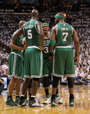 MIAMI, FL - MAY 01: Paul Pierce#34, Jermaine O'neal #7, Ray Allen #20, and Kevin Garnett #5  of the Boston Celtics talk  during game one of the Eastern Conference Semifinals of the 2011 NBA Playoffs against the Miami Heat at American Airlines Arena on May