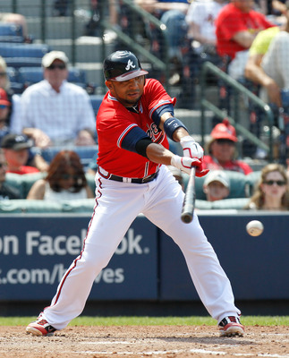 ATLANTA, GA - MAY 01:  Alex Gonzalez #2 of the Atlanta Braves hits a RBI single in the seventh inning against the St. Louis Cardinals at Turner Field on May 1, 2011 in Atlanta, Georgia.  (Photo by Kevin C. Cox/Getty Images)