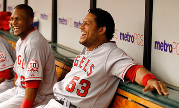 ST. PETERSBURG, FL - APRIL 30:  Outfielder Bobby Abreu #53 of the Los Angeles Angels of Anaheim smiles in the dugout against the Tampa Bay Rays during the game at Tropicana Field on April 30, 2011 in St. Petersburg, Florida.  (Photo by J. Meric/Getty Imag