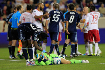 HARRISON, NJ - APRIL 30: Kei Kamara #23 of the Sporting Kansas City checks on his teammate Jimmy Nielsen #1 after he is fouled by Luke Rodgers #9 of the New York Red Bulls at Red Bull Arena on April 30, 2011 in Harrison, New Jersey. The Red Bulls defeated