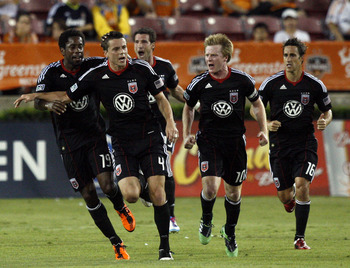 HOUSTON - APRIL 29:  Marc Burch #4 of D.C. United  celebrates with Clyde Simms #19, Dax McCarthy #10 and Josh Wolff #16 after scoring in the first half against Houston Dynamo at Robertson Stadium on April 29, 2011 in Houston, Texas.  (Photo by Bob Levey/G