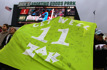 COMMERCE CITY, CO - APRIL 30:  Fans hoist a green banner with the #11 on them during the 11th minute of action between the Colorado Rapids and the Chicago Fire at Dick's Sporting Goods Park on April 30, 2011 in Commerce City, Colorado. The banner bearig '