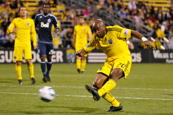 COLUMBUS, OH - APRIL 30:  Emilio Renteria #20 of the Columbus Crew connects on a shot for his second goal against the Vancouver Whitecaps FC in the second half on April 30, 2011 at Crew Stadium in Columbus, Ohio. Columbus defeated Vancouver 2-1.  (Photo b
