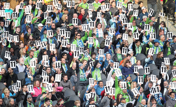 SEATTLE - APRIL 30:  Fans of the Seattle Sounders FC hold signs in honor of Steve Zakuani #11 during the game against Toronto FC at Qwest Field on April 30, 2011 in Seattle, Washington. Zakuani was injured last week and is not playing. (Photo by Otto Greu